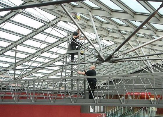 Traversing gantry with a foldable tower